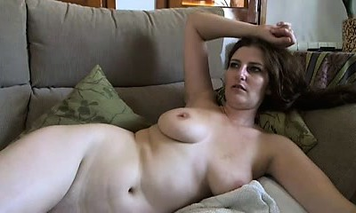 Busty mature brunette with huge orbs and hairy pussy strips