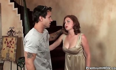 Ginger-haired momma fucks on stairs