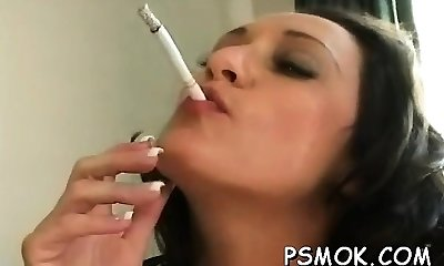 Mature doxy blows a twink while smoking a ciggie