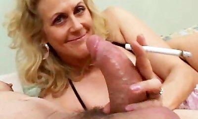 Smoking Mature Gives Blow-job To A Ginormous Cock