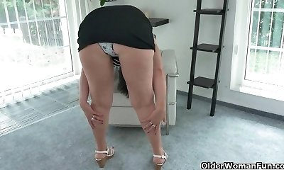 Curvy milf Ria Dark-hued takes off off her clothes and finger fucks