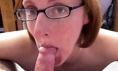 Redhead Cougar Layla Redd is on her knees to drink a dick