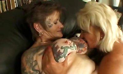 Tattooed lesbian grannie fucked