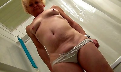 Ugly intimidating blond oldie takes a shower and teases her mature cunt