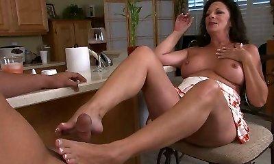 mature Margo make a feetjob