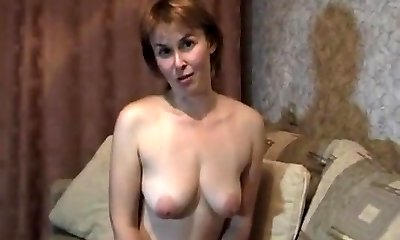 Ash-blonde mature milf at home stripteasing and fingering her honeypot