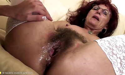Deep fisting for beautiful mature mom's hairy pussy