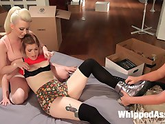 While helping Ella move into her new apartment, Cherry and Phoenix discover a box full of her kinky sex toys. Drowning in embarrassment, Ella tries to deflect from their discovery until she's pinned down, woman handled and used for Cherry and Phoenix's amusement. The double domme team spends the rest of the day helping Ella settle into her new apartment with spanking, face sitting, lift and carry, paddling, flogging, finger banging, fisting, strap-on pussy and anal, and strap-on double penetration!