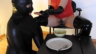 Domme forcing her slave to eat