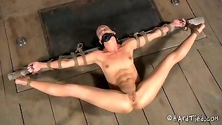 Slim brunette is held and tied up before pussy punishing