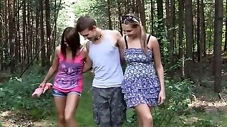 Kinky dolls are screwing in a public park having FFM threesome
