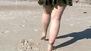 Flashing pussy at a public beach