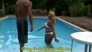 Light-haired tranny fucks by the pool
