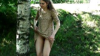 Pretty teenage gal Masha exposes her slit on camera near the road