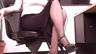 Huge-chested brunette assistant plays with a big dildo at her desk