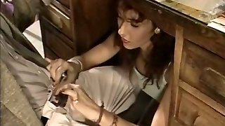 Whorey secretary gives her boss a blowjob under the table