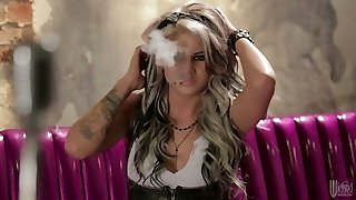 Seductive tattooed stunner is smoking and getting fucked