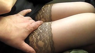 Pawing her legs in tan stockings in a bus