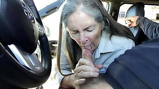 Grandma sucks in the car