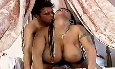 Big all-natural tits piercing