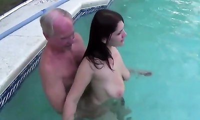 early job of April Dawn with old dude in pool
