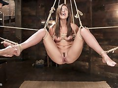 Tall, long legged all natural beauty Rilynn Rae is back on HogTied for her dose of super tight inescapable bondage and orgasm overload. Her innocent white dress belies the slutty pussy underneath, and we see to it that she gets all the perverted attention she can handle. Ball gags and nipple suckers round out an ice torment session that freezes her clit before cruel vibrations send her into spasming orgasms. Suspended pussy fucking highlights the session ending with a swollen, squirting pussy and an extremely satisfied bondage slut.