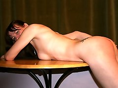 Severe caning for bare female bent across the table in pain