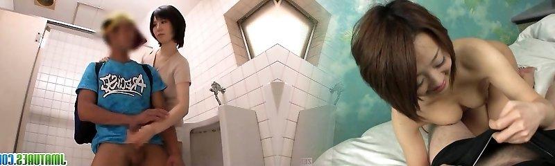 Milf gives torrid handjob in the toilet