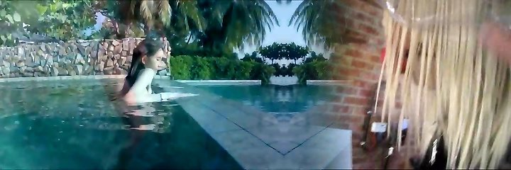 Splendid Asian Damsel in Bikini Swimming in an Edgeless Pool
