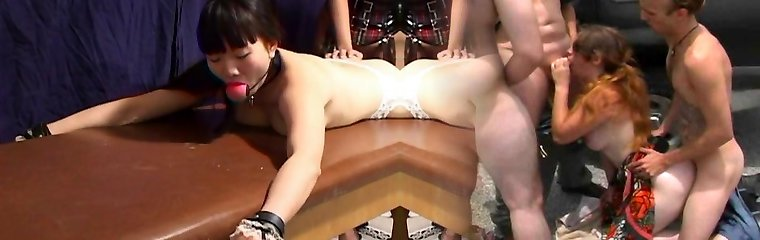 Asian sluts in leather carpet munching