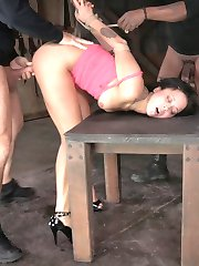 Mia Austin is a breath of fresh air. Which is kind of ironic because with all the cock we're going to cram down her throat it will be a long time before she gets one. She gets one from each end and a vibrator on her clit. The results are amazing. She's a drool covered mess on the table, her brain melted from the orgasms. We string her up into a strappado and get ready for round 2.