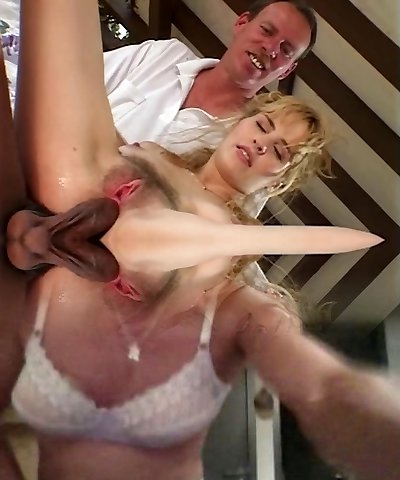 Soft c-cup blonde gets on all fours to suck two black knobs then both dudes fuck her poon