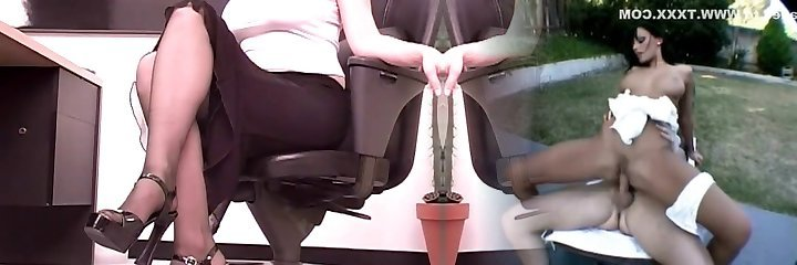 Big-boobed brunette secretary plays with a large dildo at her desk