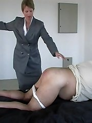 Smart lady in business suit straps guy in pain across his big fat arse