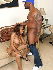 Tattooed round tit ebony cutie opens her pussy wide for a black cock