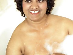 Swami loves to wear sexy red lingerie that barely covers her mature black curves. As she lays...