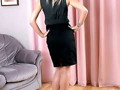 Sexy blonde Caris strolls around the house in a pair of silky stockings and shiny black stiletto...