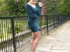 Hot babe Naomi is outdoors in a short tight dress showing off her sexy long nylon encased legs...