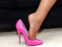 Michelle's pink shoes are so very feminine and she knows that they 'do it' for so many men. Here she gives you another chance to focus your fetish on the height of her thin heels and her deep cleavage revealing low cut fronts