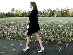 Debbies short skirt draws attention to her long legs and sexy white high stilettos