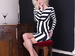 Gorgeous leggy blonde Emma shows off her amazing long legs encased in silky nylon stockings with a pair of tall white stiletto heels