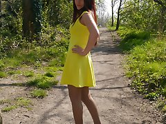 Hot Milf Jenna is wearing a beautiful yellow dress with a pair of sexy silk nylons and tall black stilettos
