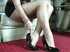 If femmes boots make you go rigid just by looking at them then Mel's lovely classy shoes will do it for you. Just sight at her skinny tapered Five inch heel, with her sensitive bow at the back and her lovely pointed fronts