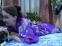 Kinky lesbians lick pantyhose clad feet and slits before nylon foot fisting