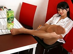 Jiggish chick teases with her nylon coated feet treating them to fresh milk