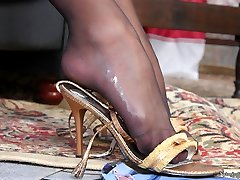 Mischievous honey squeezing stiff pole with her sexy feet in ebony stocking
