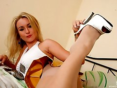 Smashing looking blondie finds pearl beads for her lovely feet in lacy hose