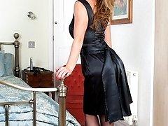 Ashleigh in tight black satin dress, sheer black RHT nylons and stilettos!