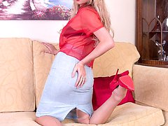 The leggy blonde MILF is sporting sheer red blouse and sexy matching panties under a tight...