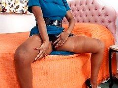 Dirty, black, mature Nina unwinds in her vintage nylons, heels and garter belt...